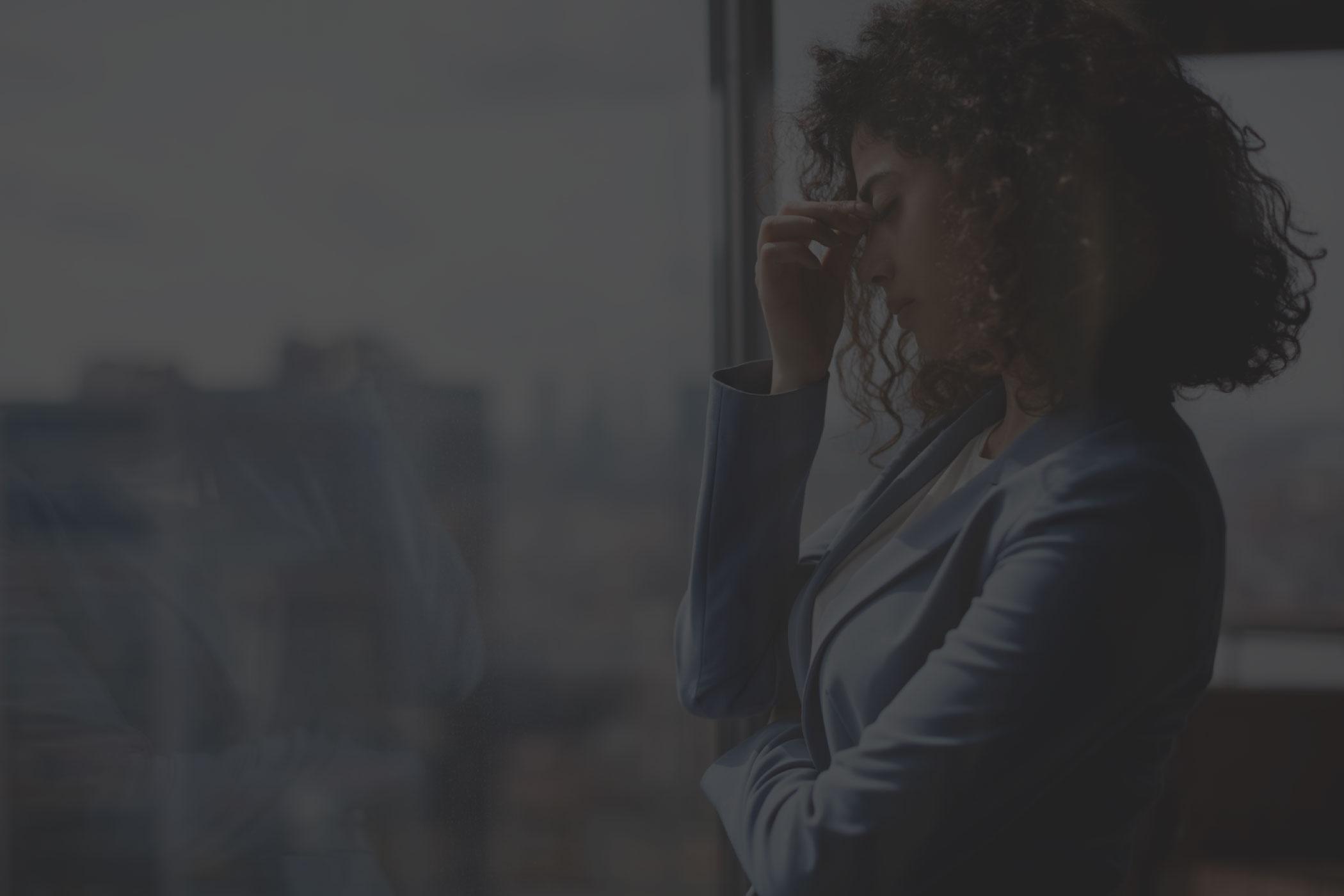 Woman with an anxiety-induced headache